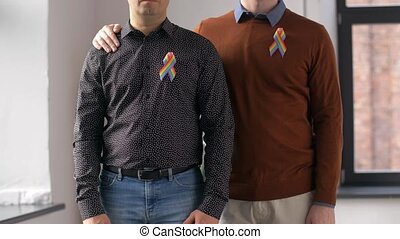male couple with gay pride awareness ribbons - people,...