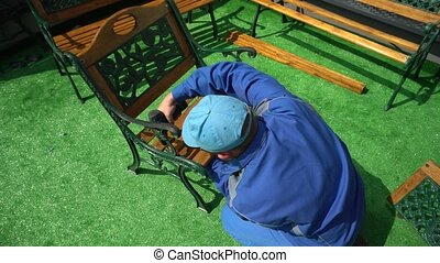 Male craftsman work with electric screwdriver repair outdoor...