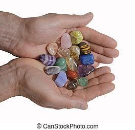 Male Crystal healer holding crystal