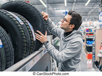 male customer choosing new tires