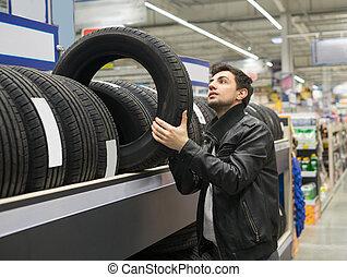 male customer choosing new tires