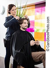 Male Customer Getting Haircut In Hair Salon