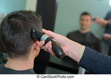 male customer having a haircut with clippers