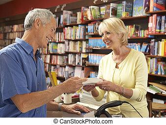 Male customer in bookshop