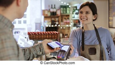 Male Customer Making Contactless Payment For Shopping Using...