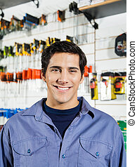 Male Customer Smiling In Hardware Shop