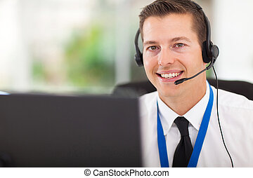 male customer support operator with headset - smiling male...