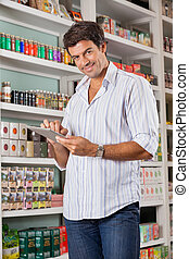 Male Customer With Digital Tablet In Store