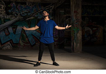 Male dancer in an abandoned building