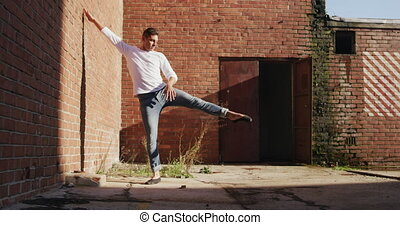 Male dancer on a rooftop - Front view of a Caucasian male ...