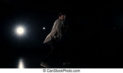 Male dancer performing on stage - Man performing a...