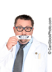 Male dentist holding picture of teeth