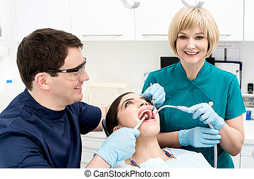 Male dentist treat the female patient