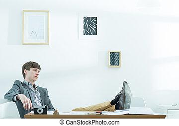 Male designer taking break