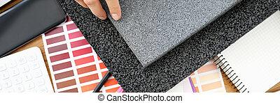 Male desinger hand hold rubber mat top view background. Modern uotdoor build materials concept