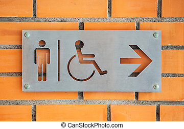 Male Disabled person Toilet Label on red brick wall