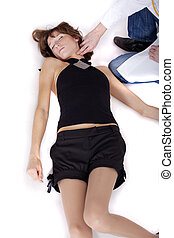 checking pulse by unconscious woman - male doctor checking...