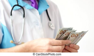 Male doctor counting dollars close-up. Corruption in...