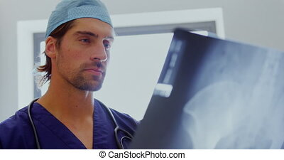 Male doctor examining x-ray report 4k