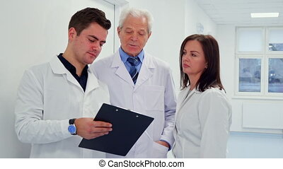 Male doctor holding clipboard in his hand