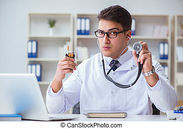 Male doctor in anti-smoking concept with cigarette pack