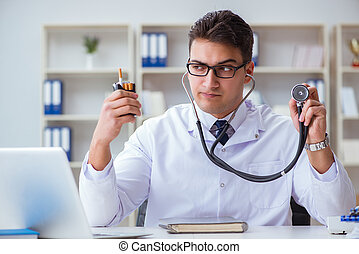 Male doctor in anti-smoking conceptwithcigarette pack