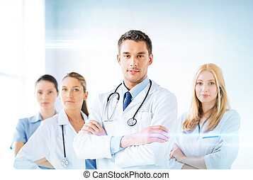 male doctor in front of medical group - attractive male...
