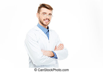 Male doctor in glasses standing with arms folded