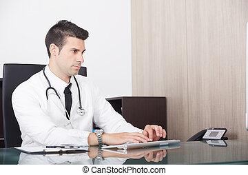 male doctor in office