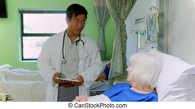 Male doctor interacting with senior patient 4k