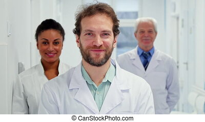 Male doctor shows his thumb up