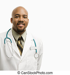 Male doctor smiling. - Portrait of smiling African-American...