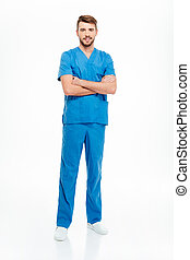 Male doctor standing with arms folded