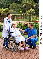 male doctor talking to senior patie