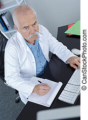 male doctor using a computer