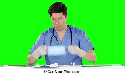 Male doctor wearing a protective mask. Green screen