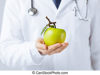 male doctor with green apple