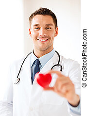 male doctor with heart - healthcare and medical concept -...