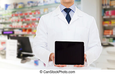 male doctor with tablet pc at drugstore