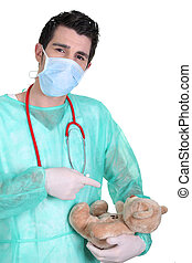 Male doctor with teddy bear