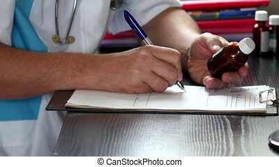 Male doctor writing rx prescription close-up