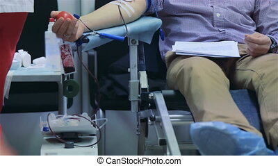 Male donor donates blood voluntarily