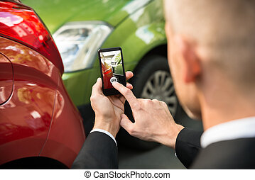 Male Driver Photographing Of Damaged Car