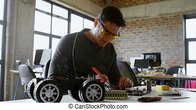 Male electrical engineer soldering a circuit board 4k - Male...