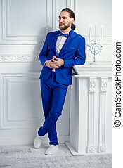 male elegant blue suit - Fashion shot. Handsome young man...