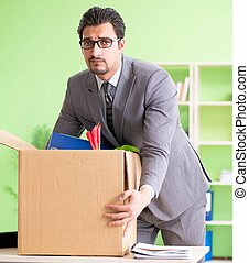 The male employee collecting his stuff after redundancy