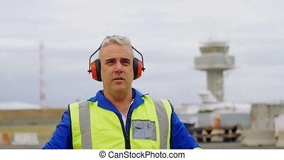Male engineer gesturing in airport 4k - Mature male engineer...