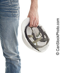 Male engineer in jeans holding white hardhat