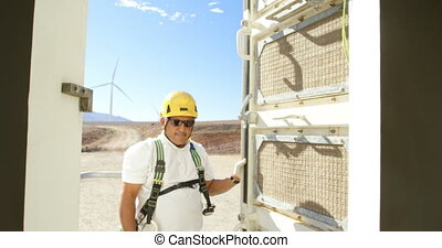 Male engineer opening the door of wind mill 4k - Male...