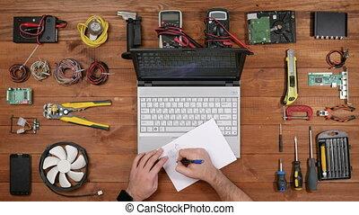Male engineer repairman draws circuitry. Crumples the paper...